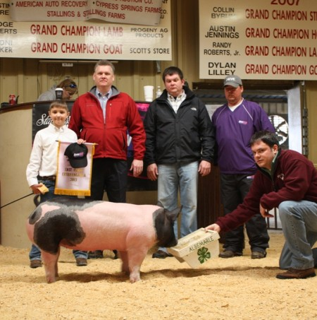 The Clark Family of Gretna, VA with the Champion Heavy Weight Pig and Reserve Champion Overall Pig at the 2013 East Coast Extravaganza