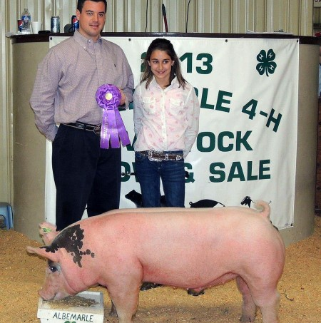 Logan Jennings with the Grand Champion at the 2013 Albemarle 4-H Livestock Show