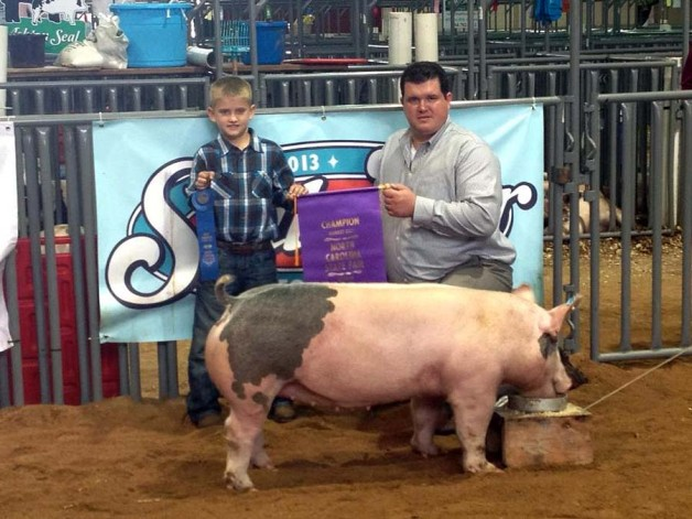 Logan Gentry with the Grand Champion Market Gilt at the 2013 North Carolina State Fair Open Show