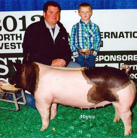 Hunter McMillen with the Ninth in Class Winner at the 2013 North American International Livestock Exposition