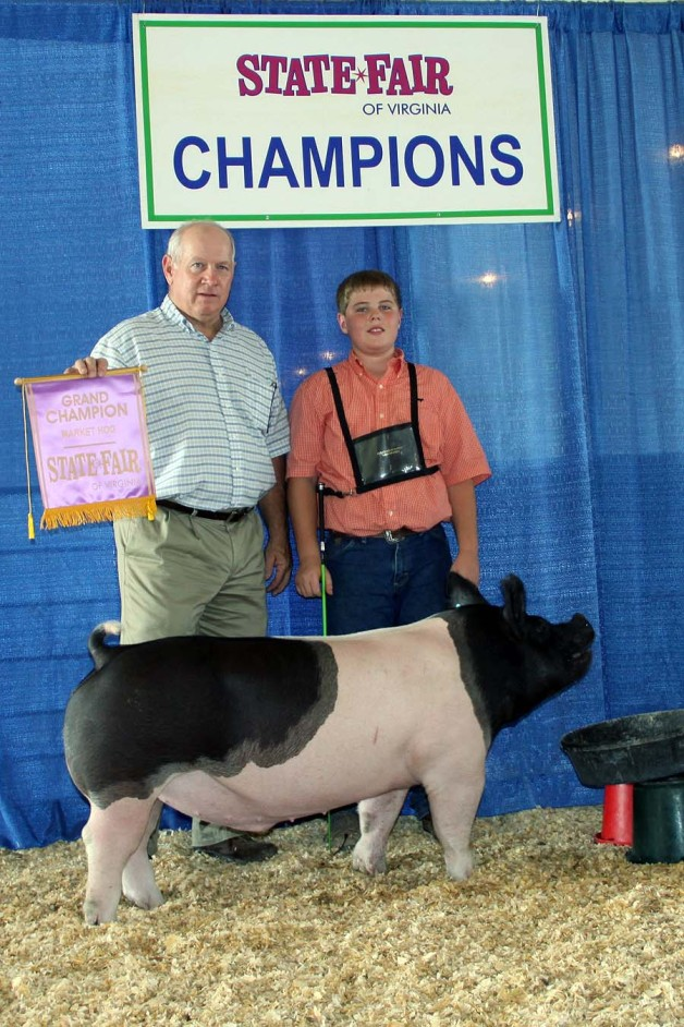 Zach McCall with the Grand Champion Market Hog at the 2013 Virginia State Fair