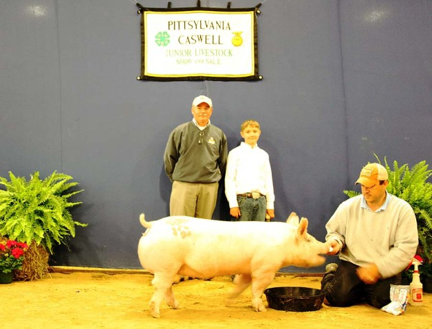 The Clark Family with the Grand Champion Market Hog at the 2014 Pittsylvania-Caswell Youth Livestock Show