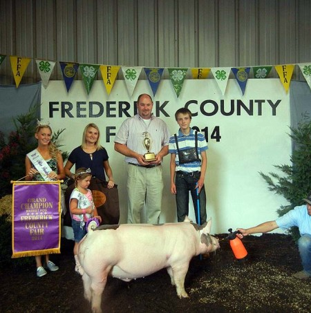 The Sfarnas Family with the Grand Champion Overall at the 2014 Frederick County, VA 4-H Livestock Show