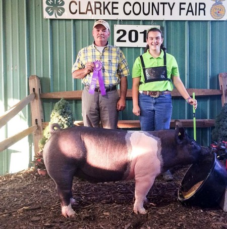 The Davis Unger Family with the Grand Champion Overall at the 2014 Clarke County, Virginia 4-H Livestock Show