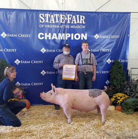The McCall Family with the Reserve Champion Barrow Overall at the 2014 Virginia State Fair