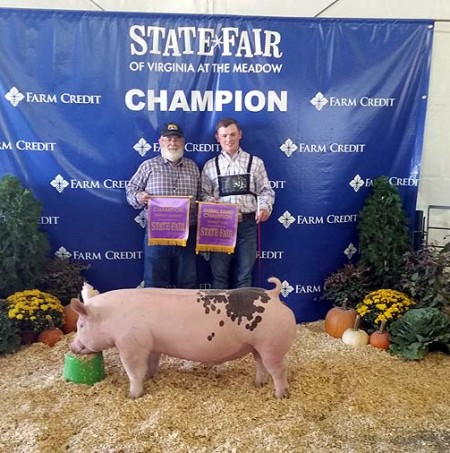 The Nixon Family with the Grand Champion Barrow Overall at the 2014 Virginia State Fair