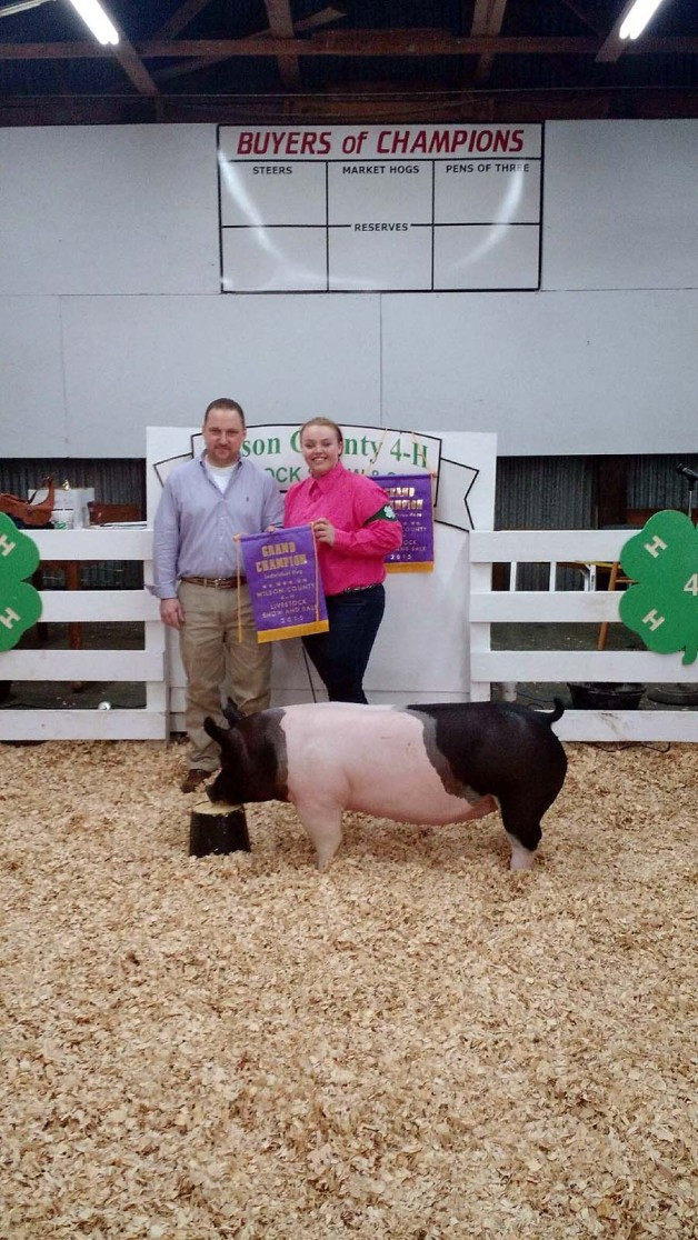 Hunter Meacomes with the Grand Champion at the 2015 Wilson County, NC 4-H Livestock Show