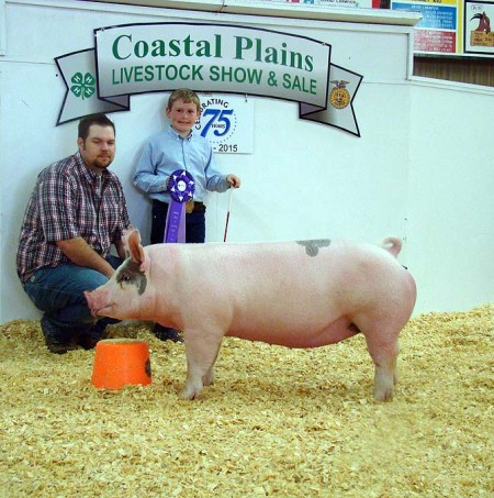 The Cox Family with the Grand Champion at the 2015 Coastal Plains Livestock Show