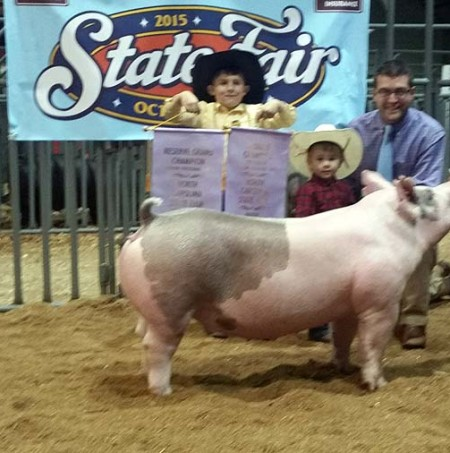 The McCoy Family with the Reserve Champion Gilt at the 2015 , NC State Fair