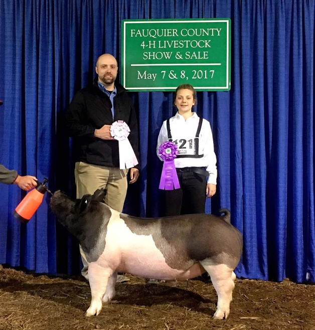 Riley Hines with the Grand Champion at the 2017 Fauquier 4-H Livestock Show
