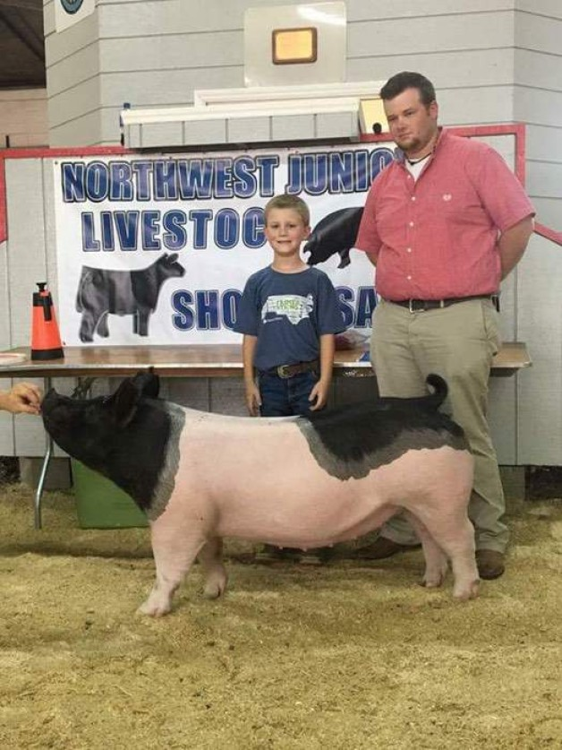 Ashton Seal with the Grand Champion at the 2017 Northwest, NC Junior Livestock Show