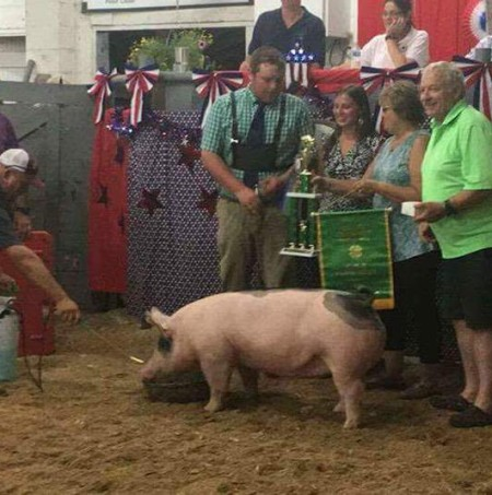 D. J. Dyer with the Grand Champion at the 2017 CMR Farm Show