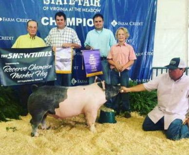 Hunter Ross with the Grand Champion Barrow: Reserve Overall Market Hog at the 2017 VA State Fair