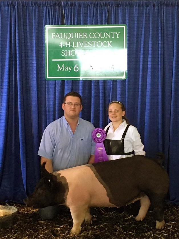 Riley Hines with the Grand Champion at the 2018 Fauquier County, VA 4-H Livestock Show
