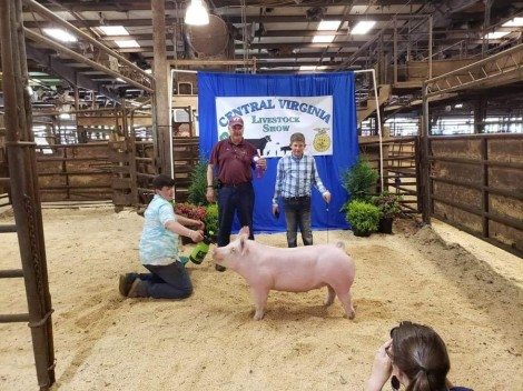 Connor Stratton with the Grand Champion at the 2019 Central Virginia Livestock Show