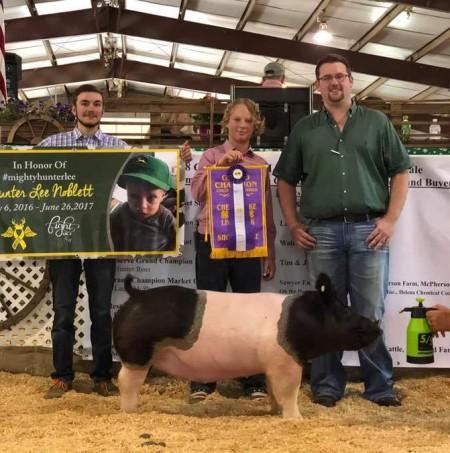 Hunter Ross with the Grand Champion at the 2019 Chesapeake, VA 4-H Livestock Show