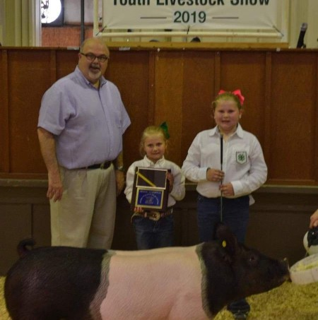 Kaylee Pittman with the Grand Champion at the 2019 Johnston County, NC Livestock Show