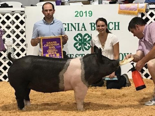 Camille Mitchel with the Grand Champion at the 2019 Virginia Beach, VA 4-H Livestock Show