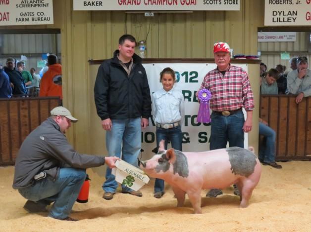 Logan Jennings with the 2012 Grand Champion Albemarle 4-H Livestock Show