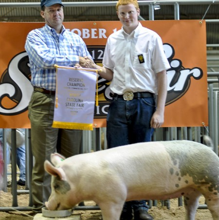 Jacob Sauls with the 2012 Reserve Champion Commercial Gilt Jr. Div. at the NC State Fair