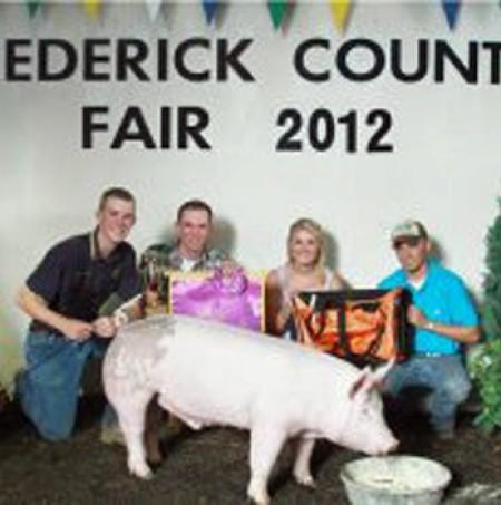 Brandon Strosnider with the 2012 Grand Champion Market Hog at the Frederick County, VA Show