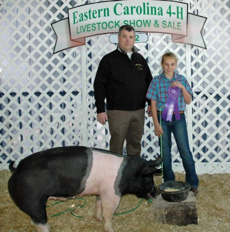 Kate Starnes with the 2012 Grand Champion at the Eastern Carolina 4-H Livestock Show