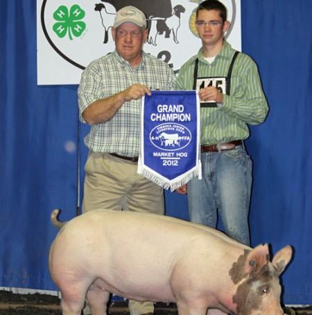 Corey Bennett with the Grand Champion Market Hog at the VA Jr Livestock Expo