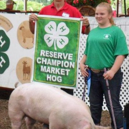 Kelsie Olah with the Reserve Champion Market Hog at the 2012 Chesapeake 4-H Livestock Show