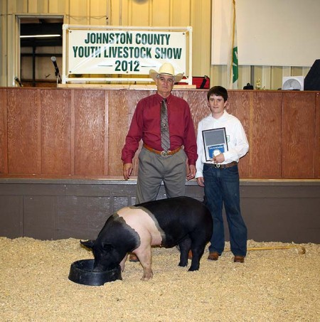 Jacob Whaley with the Grand Champion Market Hog at the 2012 Johnston County, VA Youth Livestock Show & Sale