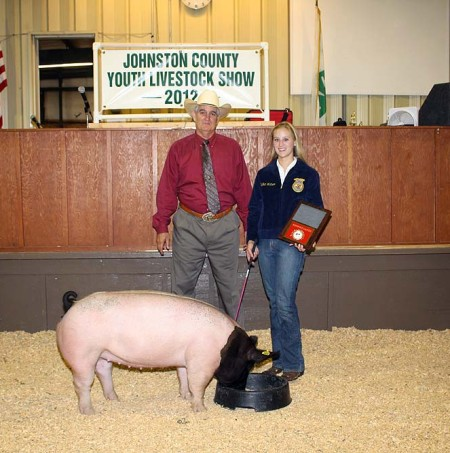 Meghan Watson with the Reserve Champion Market Hog at the 2012 Johnston County, VA Youth Livestock Show & Sale